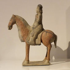 A Painted Gray Pottery Figure of an Equestrian Figure, Eastern Wei Dynasty, TL- test, H-31 cm.