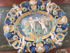"""Putti with goat"" majolica oval plate with polychrome decorations Replica of a model by Imbres manufacture"
