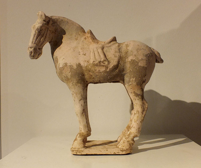 A Painted Red Pottery Figure of a Saddled Horse, Tang Dynasty, Tl-test, H- 30 cm.