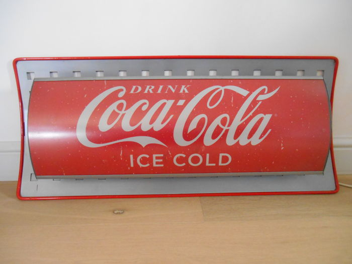 Large Coca Cola illuminated advertising from the 1980s