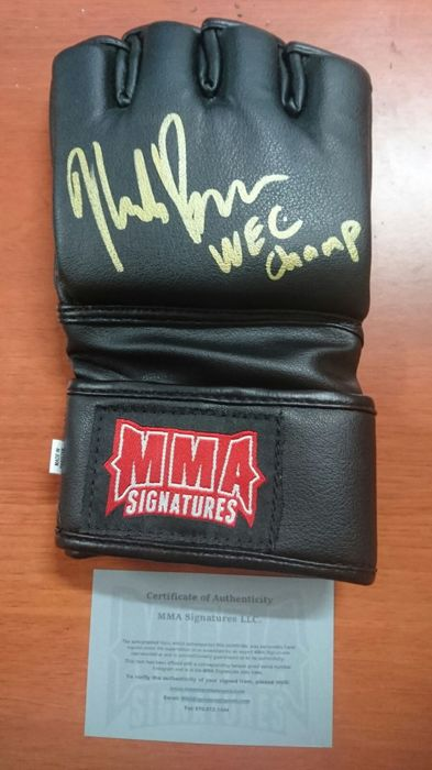 Black UFC glove with the signature of Mike Brown with certificate of authenticity of the MMA