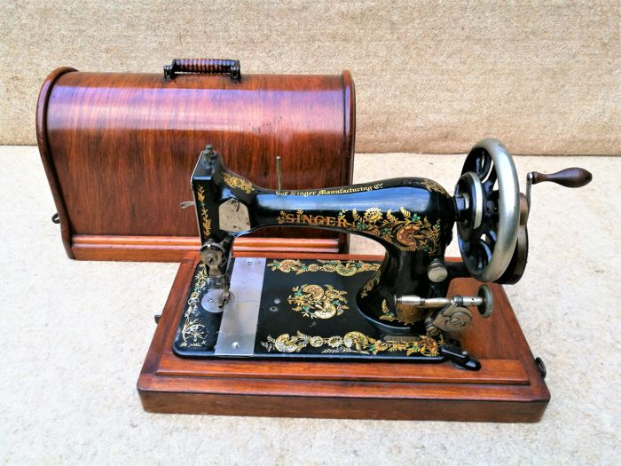 Singer sewing machine with wooden dust cover - 1896
