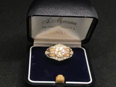 18 kt white gold ring from 1930-1940, with one central diamond and 12 accent stones for a total of 1.40 ct
