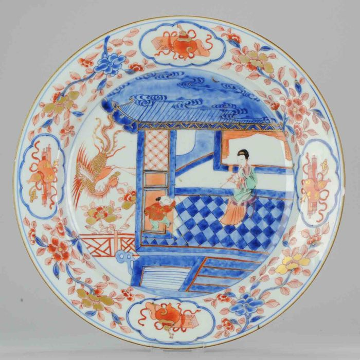 "Large porcelain charger ""Lady playing Flute with a Fenghuang¨ - China - Ca 1700"