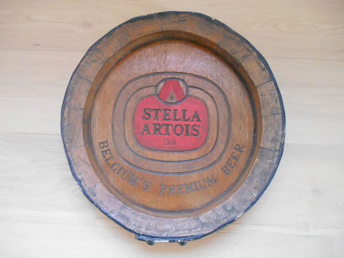 Advertising sign of Stella Artois in the shape of a lid of an oak barrel - 1980