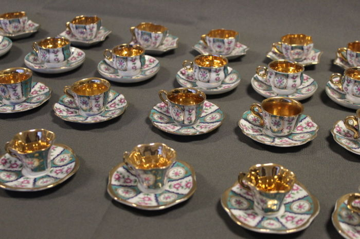 Collection of 24 miniature porcelain cups with saucers (4 sets x 6 cups and saucers)