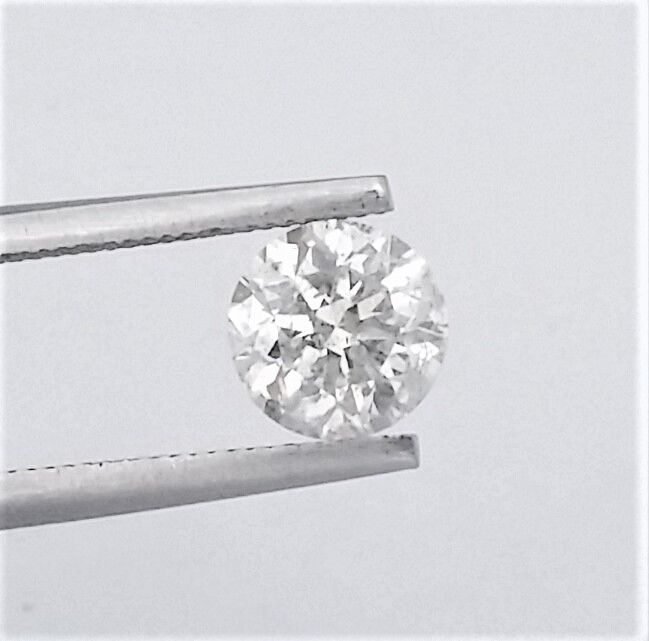 1.16 carats - Colour E - SI1 - 3 x VG - with AIG certificate and laser inscription