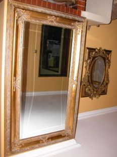 A huge classic palatial mirror in a golden wooden frame - 150 x 90 cm