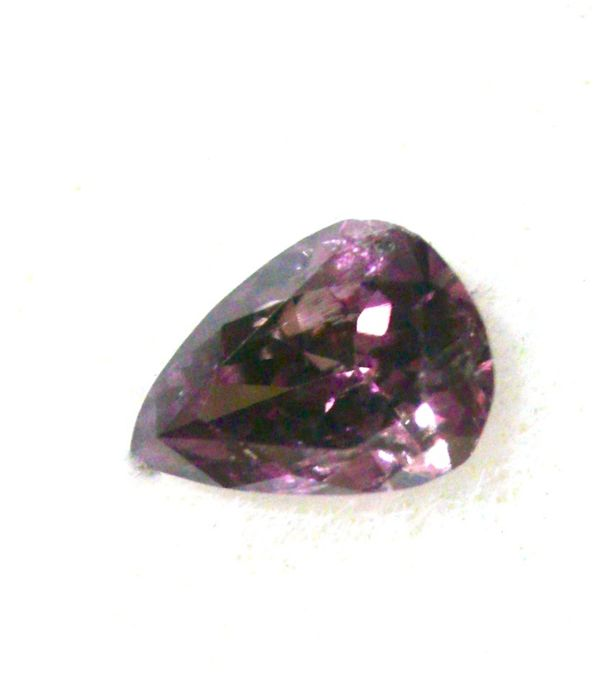 Pear-shaped GIA certified fancy dark brown-purple diamond of 0.04 ct