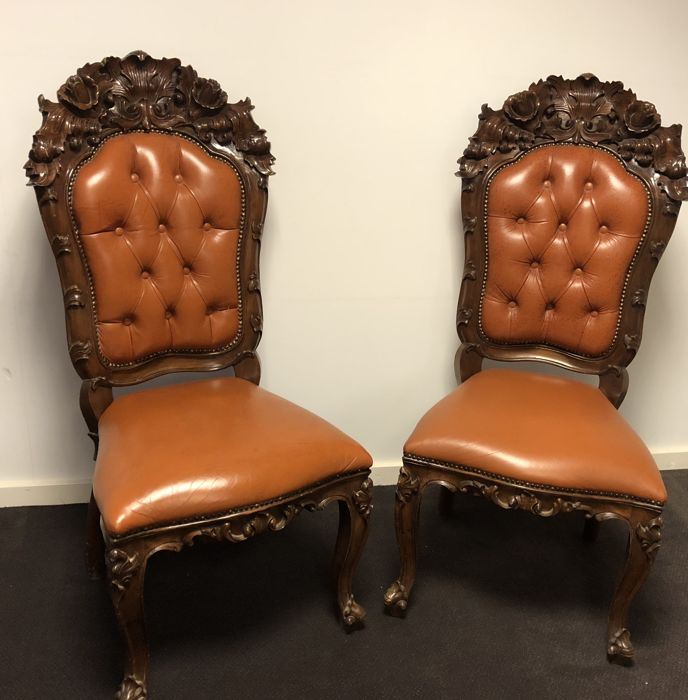 Pair of identical leather baroque armchairs, mid 20th century