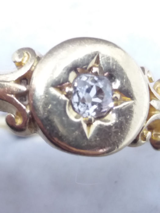 One old mined 10 point rose cut Diamond in 18k yellow gold Solitaire scroll ring. No Reserve.