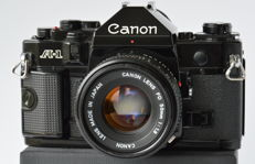 Canon A1 + 28 mm + 50 mm + accessories