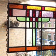 Geometric patterns in stained glass with mosaic pieces suncatcher - early 20th century Art Deco style