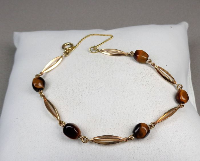 14 kt gold link bracelet with tiger's eye