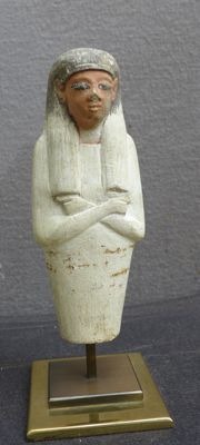 Egyptian limestone shabti with remnants of the original polychrome. H: 14.2 cm
