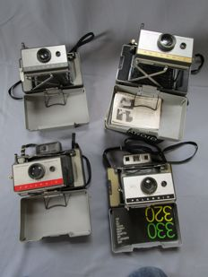 4 Polaroid cameras - model 103 / 104 / 215 original packaging / 320