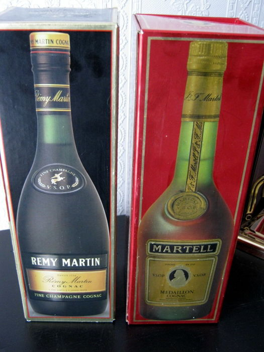 Two bottles of Cognac - Rémy Martin and Martell between 1985 and 1994