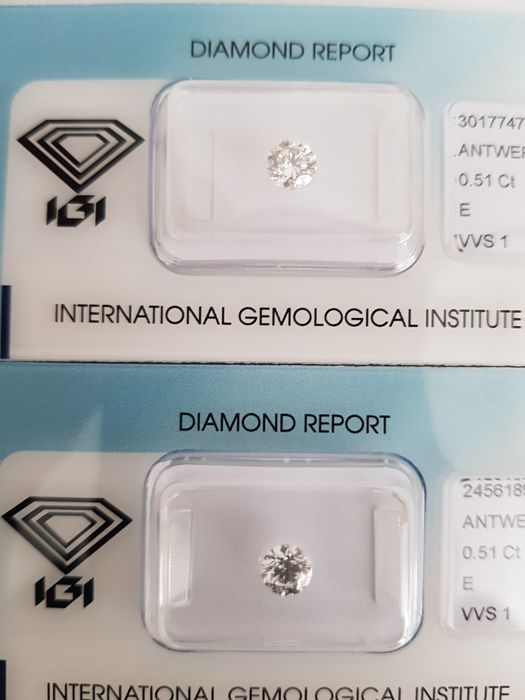 A pair of brilliant cut diamonds, 1.02 ct in total, E VVS1