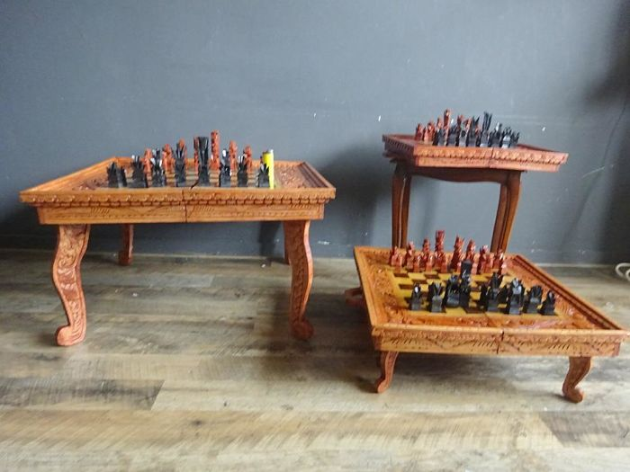 Lot of 3 Balinese entirely handmade wooden chessboards, including 2 table models, Bali, ca. 1990