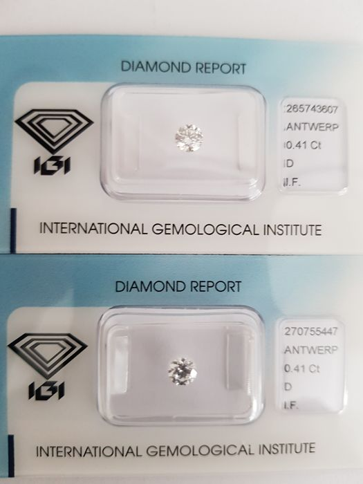 A pair of brilliant cut diamonds of 0.82 ct in total, D I.F