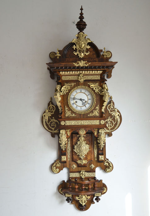 Wall Clock with brass decorations walnut case - Gustav Becker movement