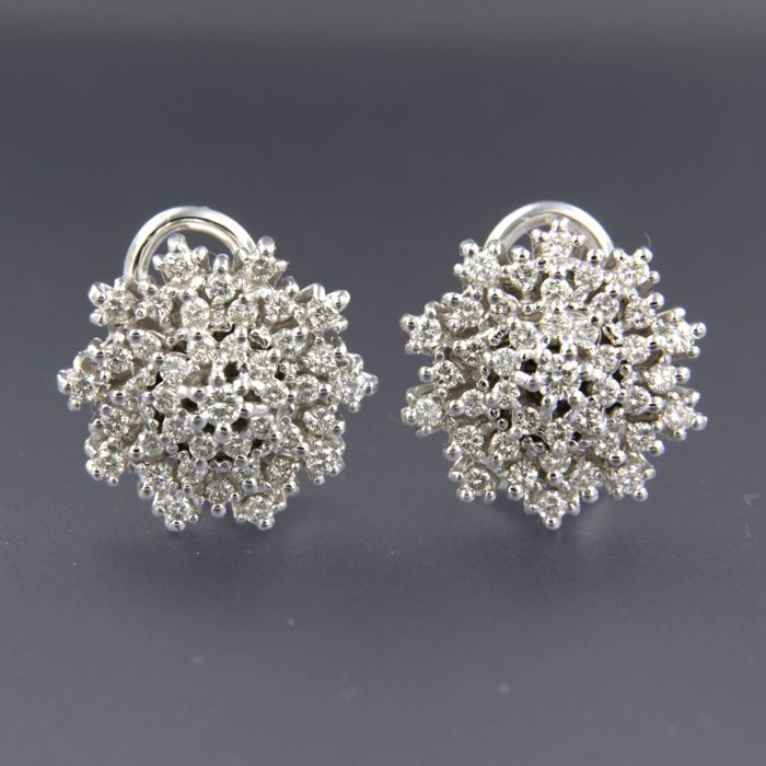 14 kt white gold entourage clip-on earrings set with 82 brilliant cut diamonds, 1.50 ct in total