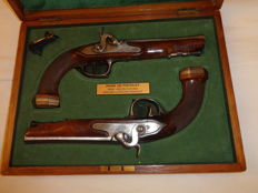 Pair of French Officer Combat pistols, 1 First EMPIRE 1804/1816 model transformed into percussion, in  a presentation case.