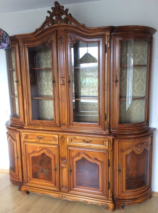 Walnut display cabinet, consisting of two parts, lower cabinet with shelves and wall unit with glass doors