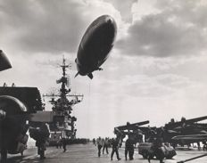 Unknown - US Navy blimp over aircraft carrier, 1950/60s