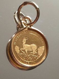 "Pendant ""Springbuck Investment"" 750. - 999.9/1000 Gold; Frame Diameter: 11.93mm"