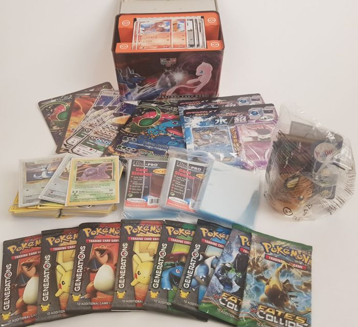 Lot of 8 Pokemon boosters / cards and other pokemon products.