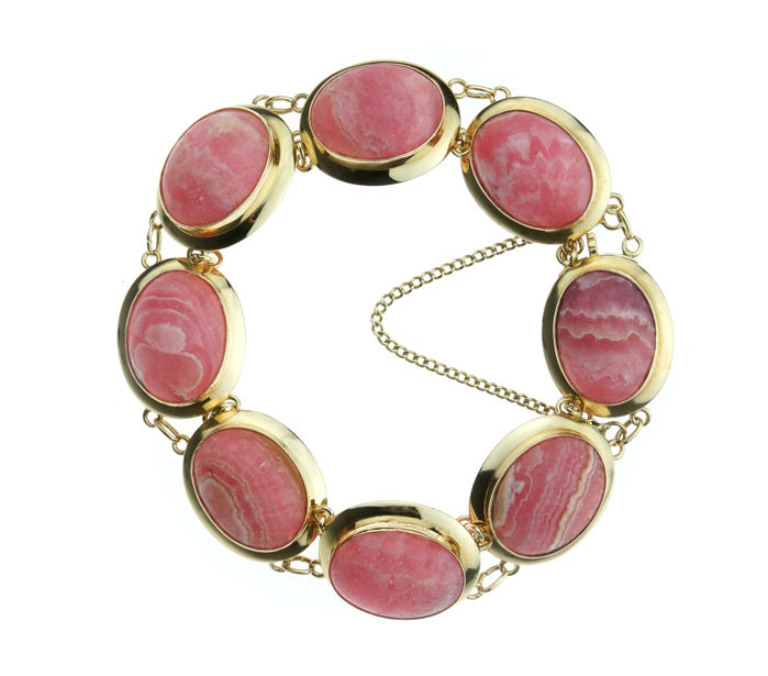 Exclusive 14 kt yellow gold link bracelet set with cabochon cut rhodochrosites