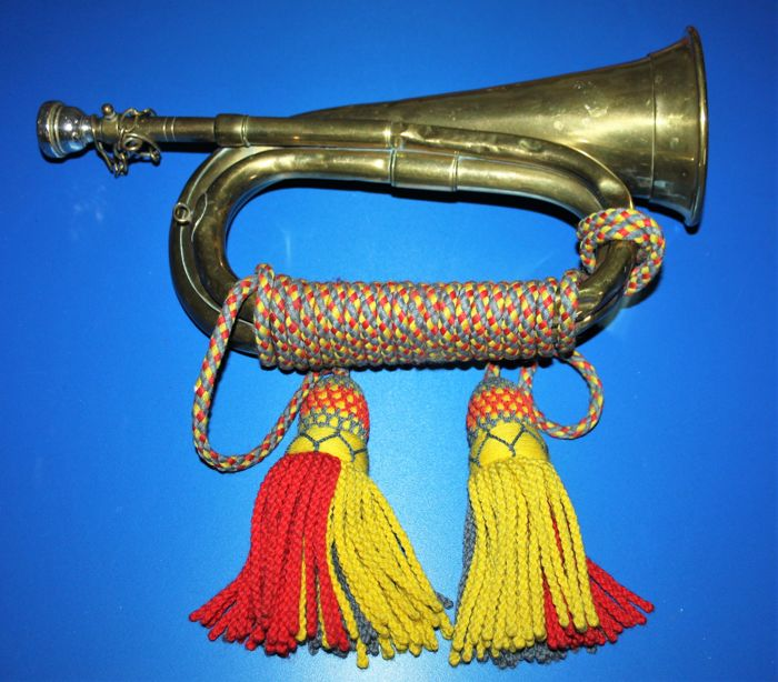A Military Bugle, marked with broad arrow and regimental colors and dated 1966, Maker: Mayers & harrison Ltd.,  brass,  in  good working condition