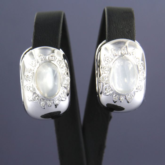 18 kt white gold creole earrings, set with a moonstone and 30 brilliant cut diamonds of approx. 0.30 ct in total.