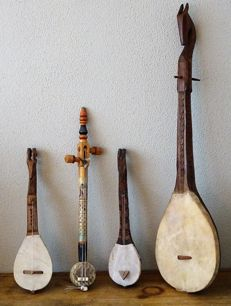 4 decorative African string instruments