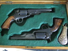 two belgium 6 shot  brevet percussion colts one 35cal the other 44? leige proof marks in a display case