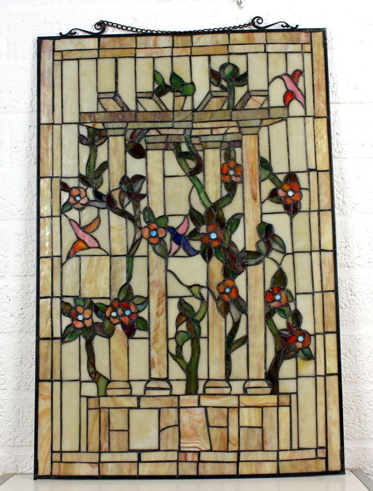 Stained glass window - architectural depiction of classic columns with flower vines