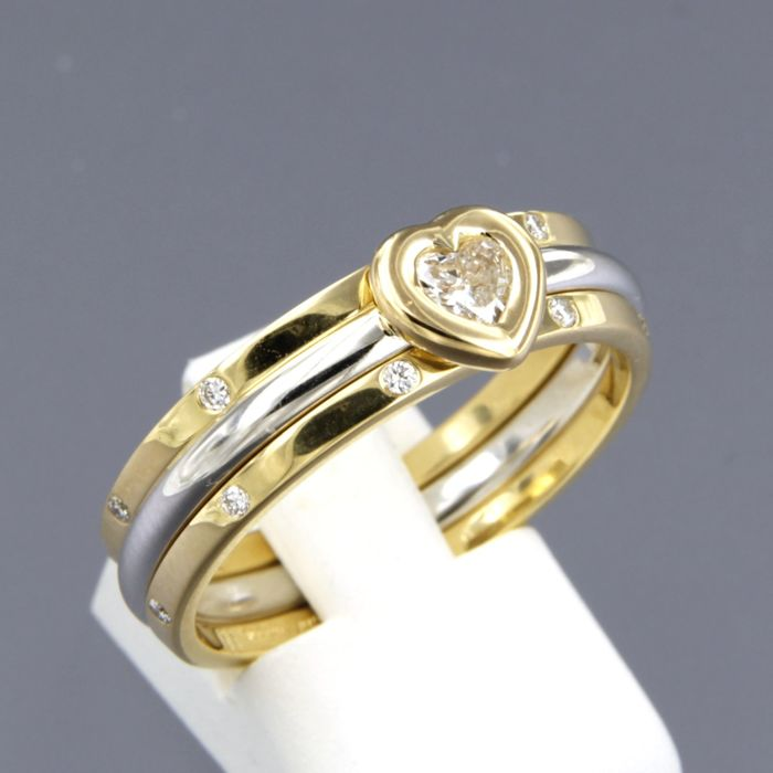 18 kt bi-colour gold ring set with a heart shaped diamond and 2 yellow gold stacking rings set with brilliant cut diamonds, approx. 0.40 carat in total