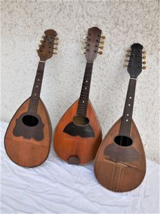 Three old eight-stringed mandolins, marked with Louis Morra, R. Garelli, and unknown