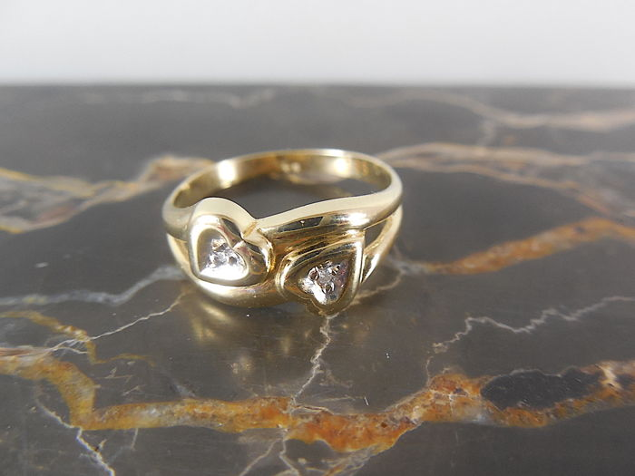 14 K yellow gold ring with diamonds