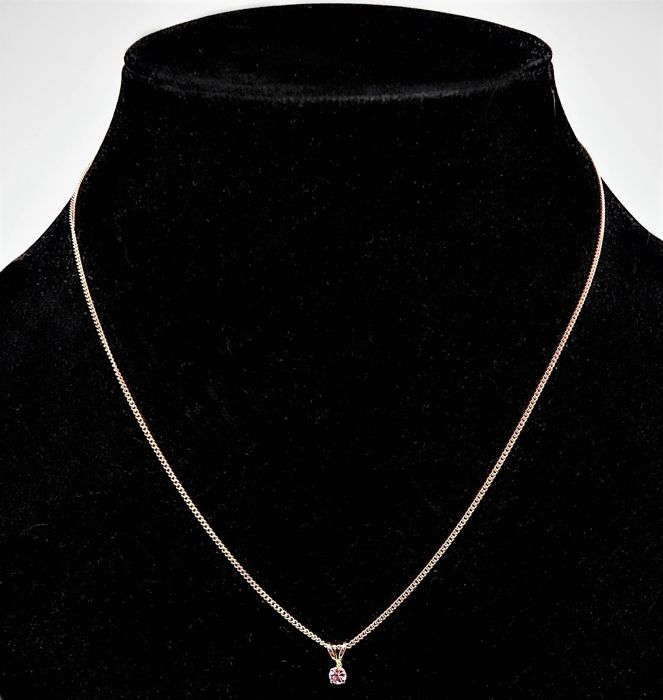 New 18 kt gold necklace and 14kt gold white sapphire pendant chain new 18 kt gold necklace and 14kt gold white sapphire pendant chain length 44 aloadofball