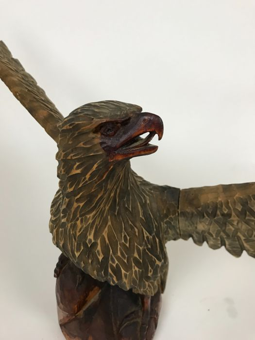 Large hand-carved sculpture of an eagle