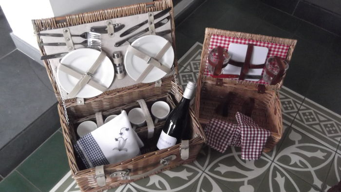 Two English wicker picnic baskets complete with accessories