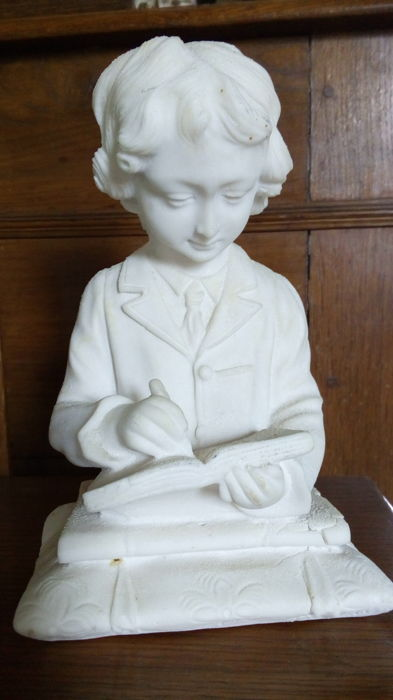 Schoolboy writing in his notebook - signed statuette - restored white stone, 20th century, France