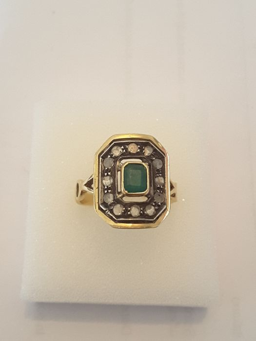 Ring with 1 0.70 carat emerald and 12 old hollow cut diamonds All stones are natural untreated. Please bear in mind that when the ring was made it was not possible to modify the gemstones