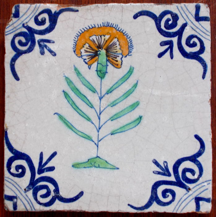 Rare, intact tile with a depiction of a carnation, Holland, ca. 1620-1640