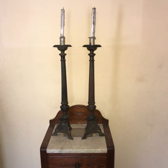 A pair of copper candlesticks, early 20th century