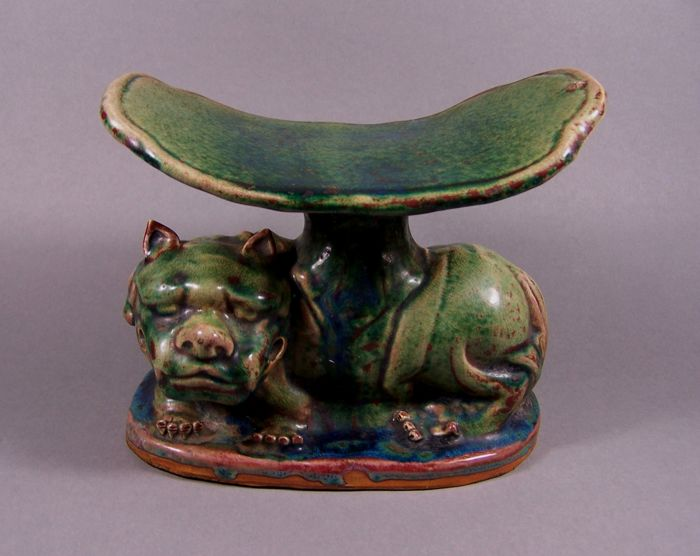 A  so-called 'emaillé sur biscuit' neck rest mounted on a reclining Buddhist lion - China - late 19th century