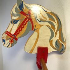 Old rare wooden stick horse - with four silkscreen colours and on wooden wheels - England - circa 1950