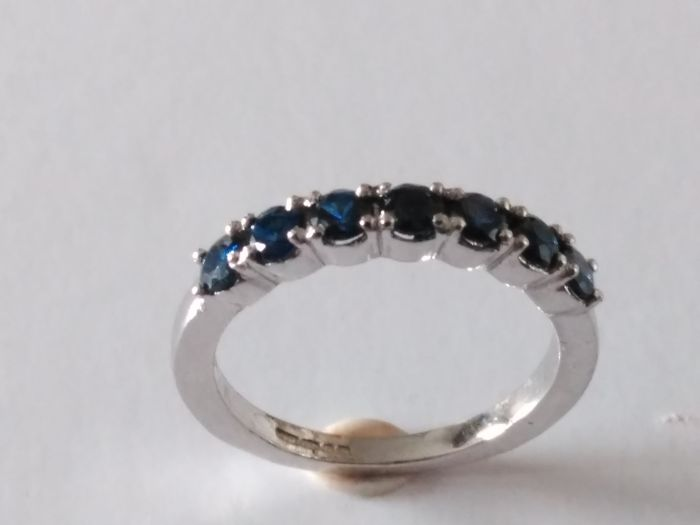 Gold cocktail ring with 7 sapphires